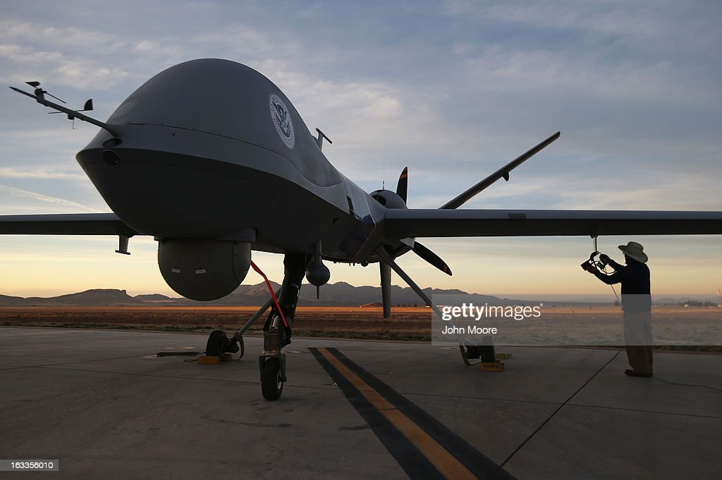 Maintenence personel check a Predator drone operated by US Office of Air and Marine before its surveillance flight near the Mexican border on March 7...