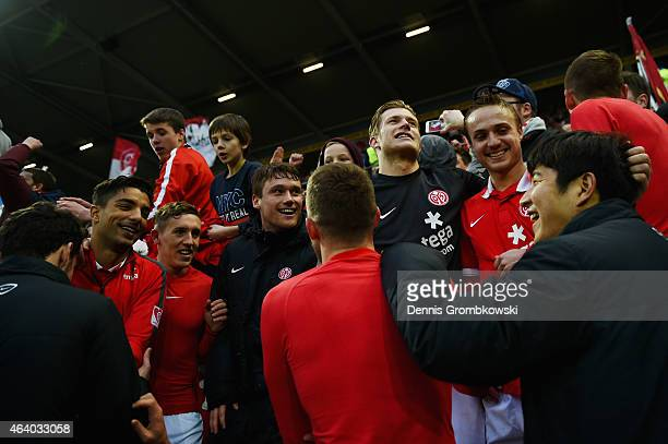 Mainz 05 players celebrate with fans after the Bundesliga match between 1 FSV Mainz 05 and Eintracht Frankfurt at Coface Arena on February 21 2015 in...