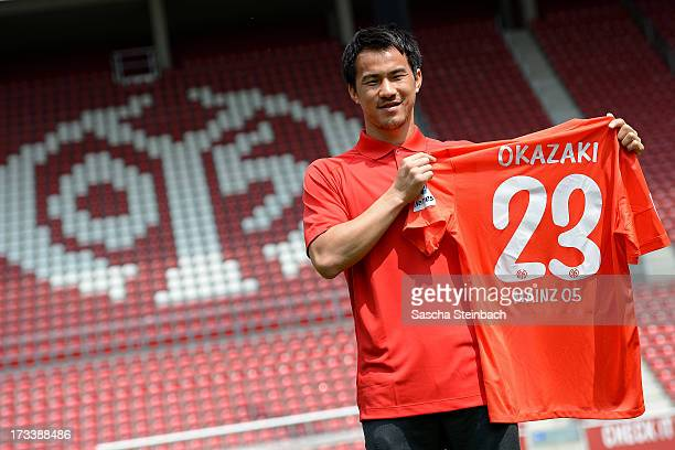 Mainz 05's new player Shinji Okazaki poses during his official presentation at Coface Arena on July 13 2013 in Mainz Germany
