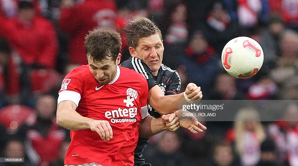 Mainz' Austrian midfielder Andreas Ivanschitz (L) and Bayern Munich's midfielder Bastian Schweinsteiger vie for the ball during the German first division Bundesliga football match 1. FSV Mainz 05 vs. Bayern Munich in Mainz, southwestern Germany, on February 02, 2013.