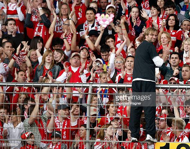 Mainz coach Juergen Klopp celebrates with the Fans during the 2nd Bundesliga match between FSV Mainz 05 and FC StPauli at the Bruchweg Stadium in...
