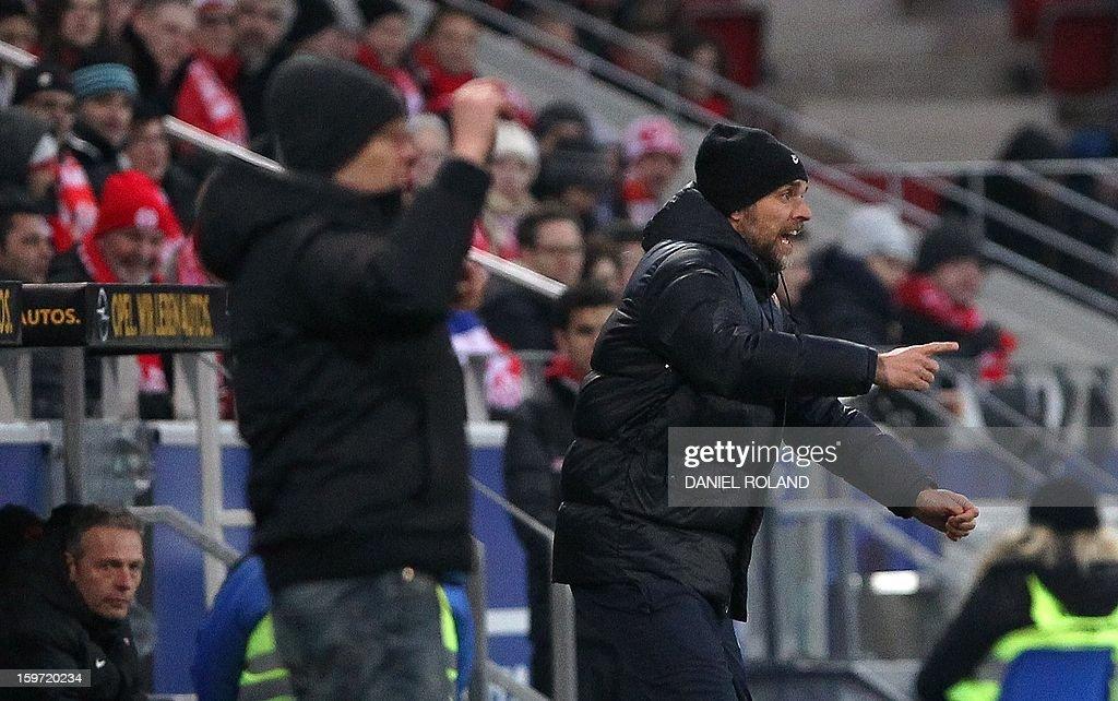 Mainz' coach Thomas Tuchel (R) and Freiburg's coach Christian Streich react during the German first division Bundesliga football match 1.FSV Mainz 05 vs. SC Freiburg, in Mainz, southwestern Germany, on January 19, 2012.