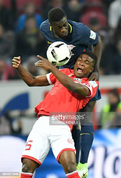 Mainz' Colombian forward Jhon Andres Cordoba and Leipzig's French defender Dayotchanculle Oswald Upamecano vie for the ball during the German first...