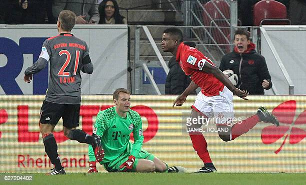 Mainz' Colombian forward Jhon Andres Cordoba celebrates scoring the opening goal past Bayern Munich's goalkeeper Manuel Neuer during the German first...