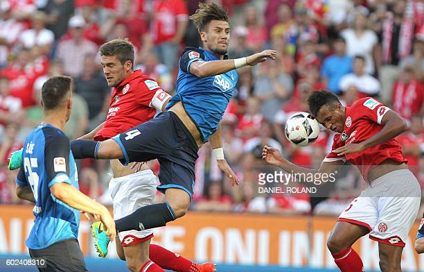 Mainz' defender Stefan Bell and Mainz' French midfielder Jean Philippe Gbamin and Hoffenheim's Bosnian defender Ermin Bicakcic vie for the ball...