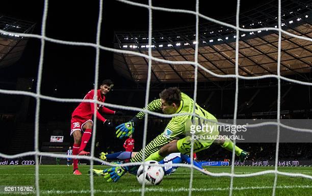 Mainz' forward Aaron seydel scores the opening goal past Berlin's Norwegian goalkeeper Rune Almenning Jarstein during the German first division...