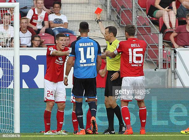 Mainz' French defender Gaetan Bussmann gets a red card by referee Markus Schmidt during the German first division Bundesliga football match between...