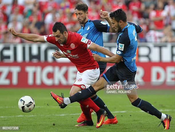Mainz' midfielder Levin Oeztunali and HHoffenheim's midfielder Lukas Rupp vie for the ball during the German first division Bundesliga football match...