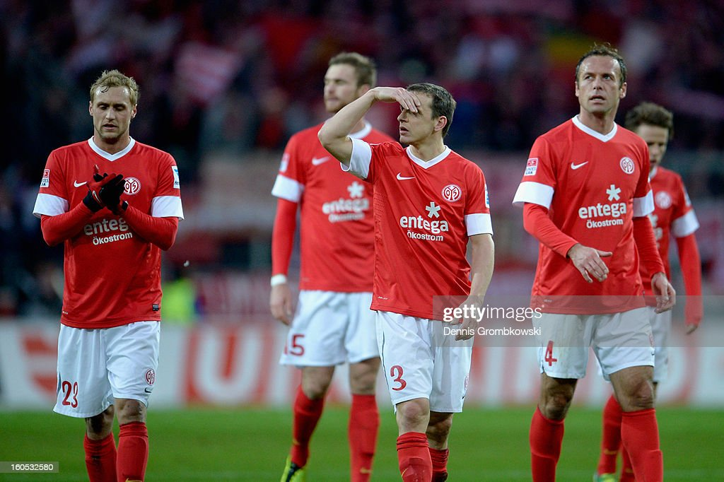 Mainz players look dejected after the Bundesliga match between 1. FSV Mainz 05 and FC Bayern Muenchen at Coface Arena on February 2, 2013 in Mainz, Germany.