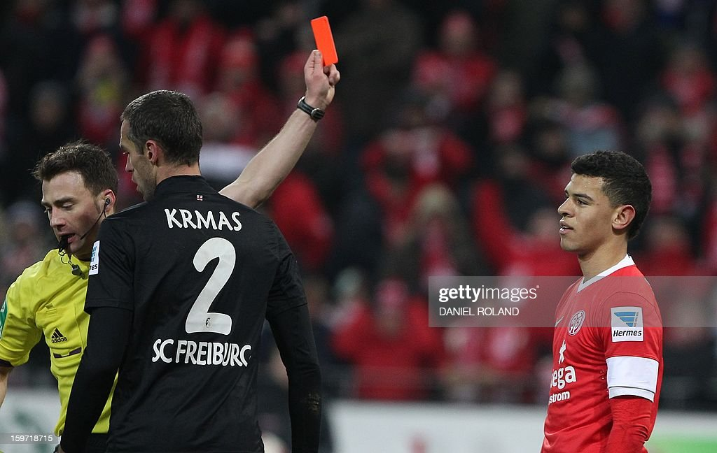 Mainz' Shawn Parker (R) receives a red card from referee Felix Zweyer (L) during the German first division Bundesliga football match 1.FSV Mainz 05 vs. SC Freiburg, in Mainz, southwestern Germany, on January 19, 2012.