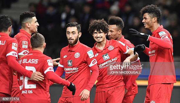 Mainz's forward Aaron Seydel celebrates scoring the opening goal with teammates during the German first division Bundesliga football match between...
