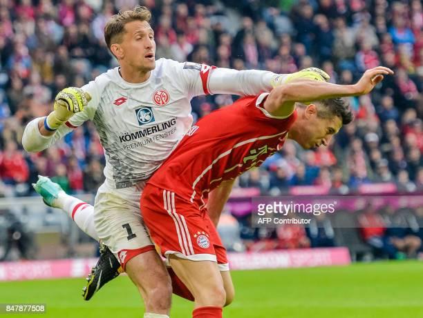 Mainz's German goalkeeper Rene Adler and Bayern Munich's Polish striker Robert Lewandowski vie for the ball during the German First division...