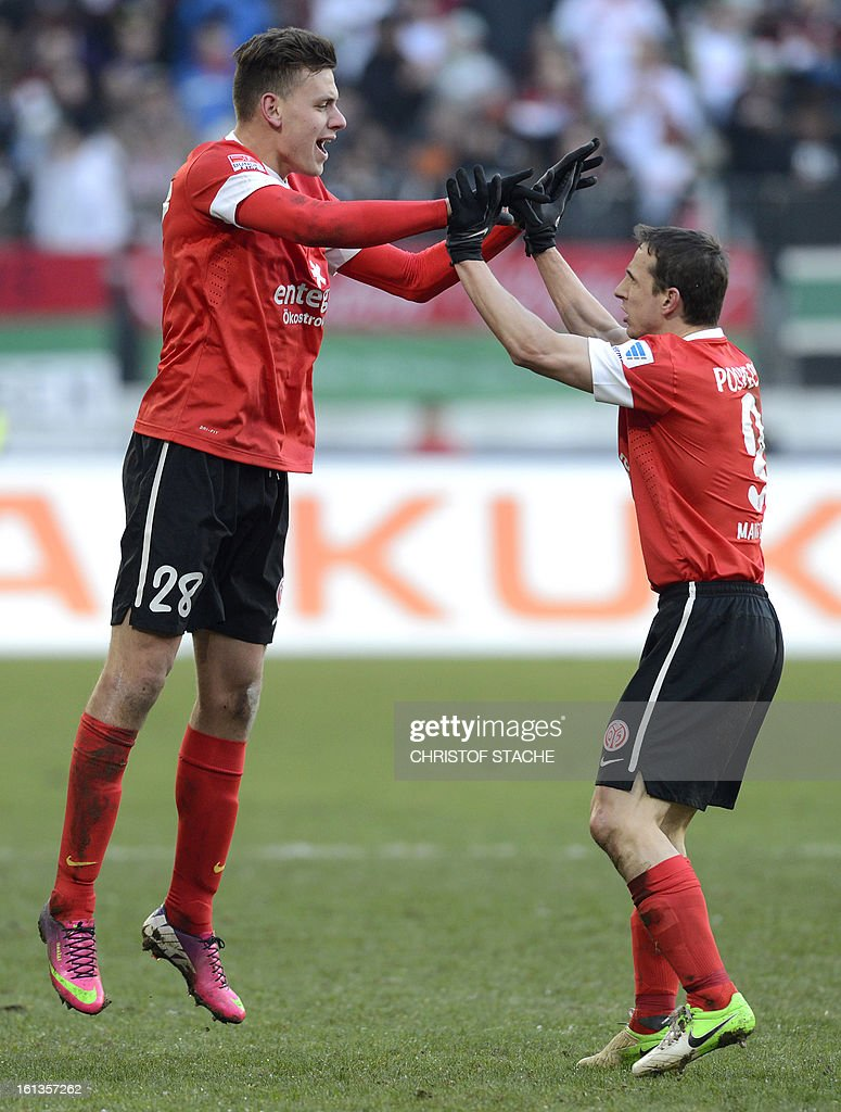 Mainz's Hungarian striker Adam Szalai and his teammate Mainz's Czech defender Zdenek Pospech celebrate after the first goal for Mainz during the German first division Bundesliga football match between FC Augsburg and FSV Mainz 05 in Augsburg, southern Germany, on February 10, 2013.
