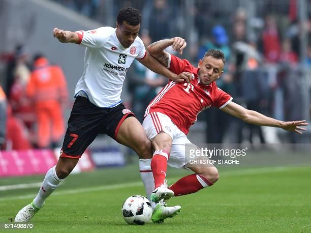 MainzÕs Swedish midfielder Robin Quaison and Bayern Munich's Brazilian defender Rafinha vie for the ball during the German First division Bundesliga...