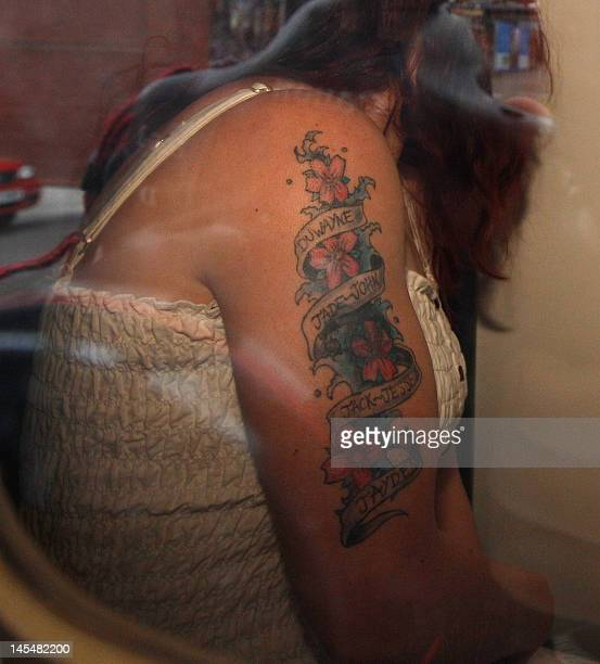 Mairead Philpott is driven away from Southern Derbyshire Magistrates' Court in Derby England on May 31 2012 in a prison van after being remanded in...