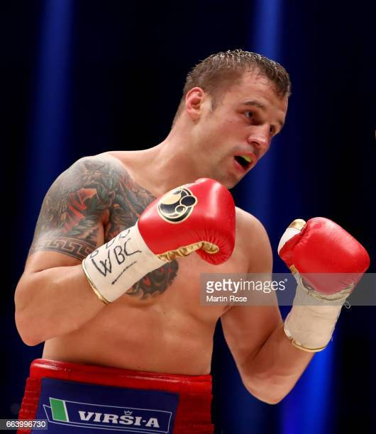 Mairis Briedis of Latvia in action against Marco Huck of Germany during their WBC Cruiserweight World Championship title fight at Westfalenhalle on...