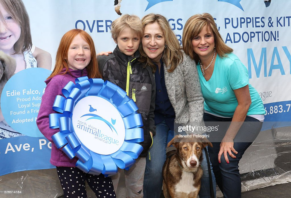 Maisy Falco, Anderson Falco, Edie Falco with their rescue dog Niko and Donna Lawrence attend the 22nd Annual Global Pet Adoption Event at North Shore Animal League America on April 30, 2016 in Port Washington, New York.