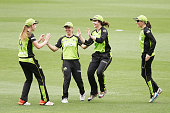 Maisy Gibson of the Sydney Thunder celebrates with teammates after she got the wicket of Nicole Bolton of the Perth Scorchers during the Women's Big...