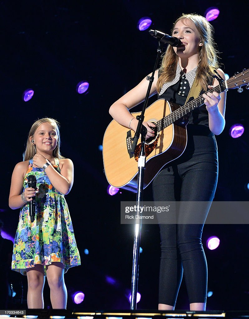 Maisy Stella and Lennon Stella from the ABC drama Nashville perform during the 2013 CMA Music Festival on June 9, 2013 in Nashville, Tennessee.