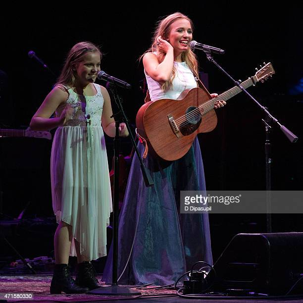 Maisy Stella and Lennon Stella perform onstage during the 'Nashville' Tour at The Beacon Theatre on April 29 2015 in New York City