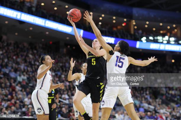 Maite Cazorla of the Oregon Ducks drives to the basket defended by Gabby Williams of the Connecticut Huskies during the UConn Huskies Vs Oregon Ducks...