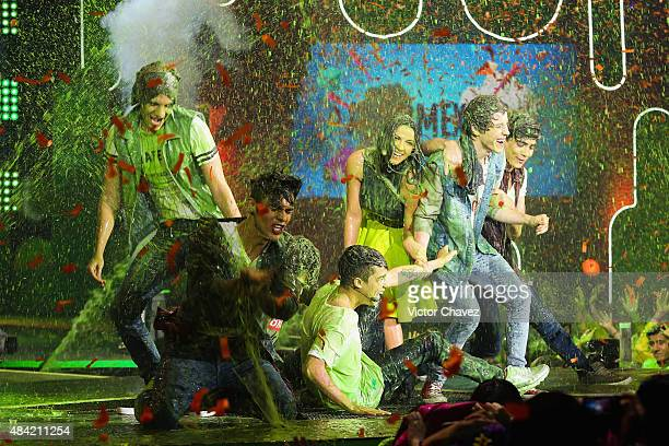 Maite Perroni and members of the band CD9 get slimed onstage during the Nickelodeon Kids' Choice Awards Mexico 2015 at Auditorio Nacional on August...