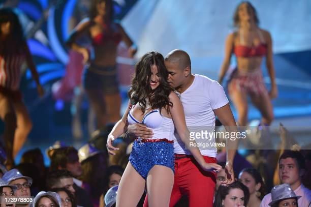 Maite Perroni performs onstage during the Premios Juventud 2013 at Bank United Center on July 18 2013 in Miami Florida