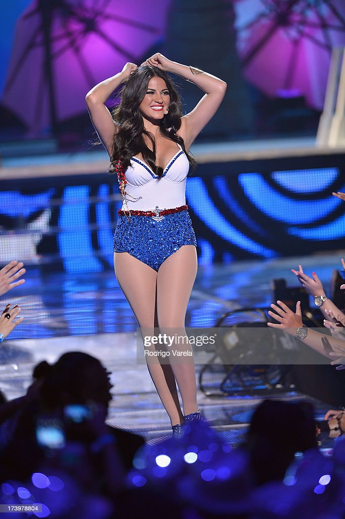 <a gi-track='captionPersonalityLinkClicked' href=/galleries/search?phrase=Maite+Perroni&family=editorial&specificpeople=4080362 ng-click='$event.stopPropagation()'>Maite Perroni</a> performs onstage during the Premios Juventud 2013 at Bank United Center on July 18, 2013 in Miami, Florida.