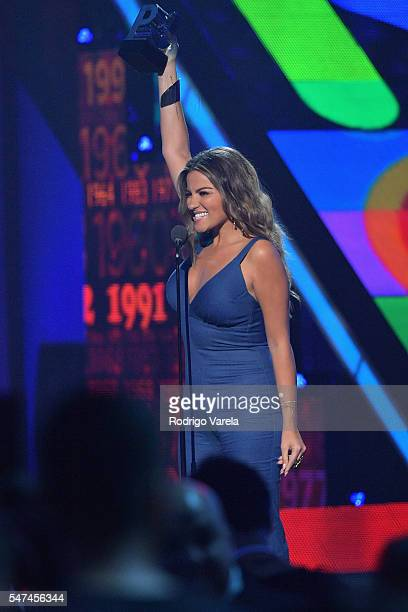 Maite Perroni recieves award onstage at the Univision's 13th Edition Of Premios Juventud Youth Awards at Bank United Center on July 14 2016 in Miami...