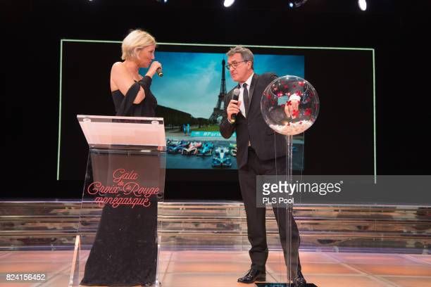 Maitena Biraben and Francois Cluzet speak on stage at the 69th Monaco Red Cross Ball Gala at Sporting MonteCarlo on July 28 2017 in MonteCarlo Monaco