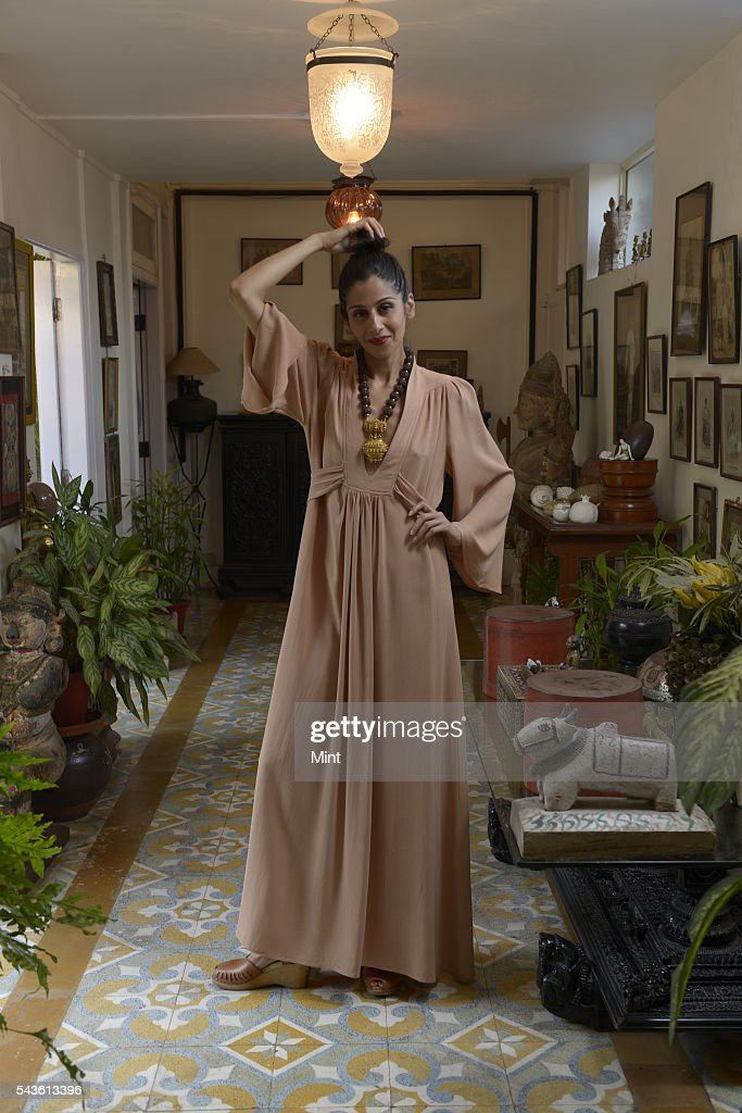 Maithili Ahluwalia in a vintage kaftan by Ossie Clark paired with a south Indian temple necklace on November 28, 2013 in Mumbai, India. Maithili Ahluwalia is founder of Mumbais Bungalow 8, the popular fashion and lifestyle destination.