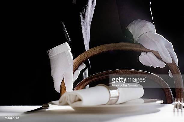 maitre d' preparing dining table