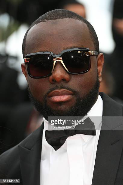 Maitre Gims attends a screening of 'The BFG' at the annual 69th Cannes Film Festival at Palais des Festivals on May 14 2016 in Cannes France