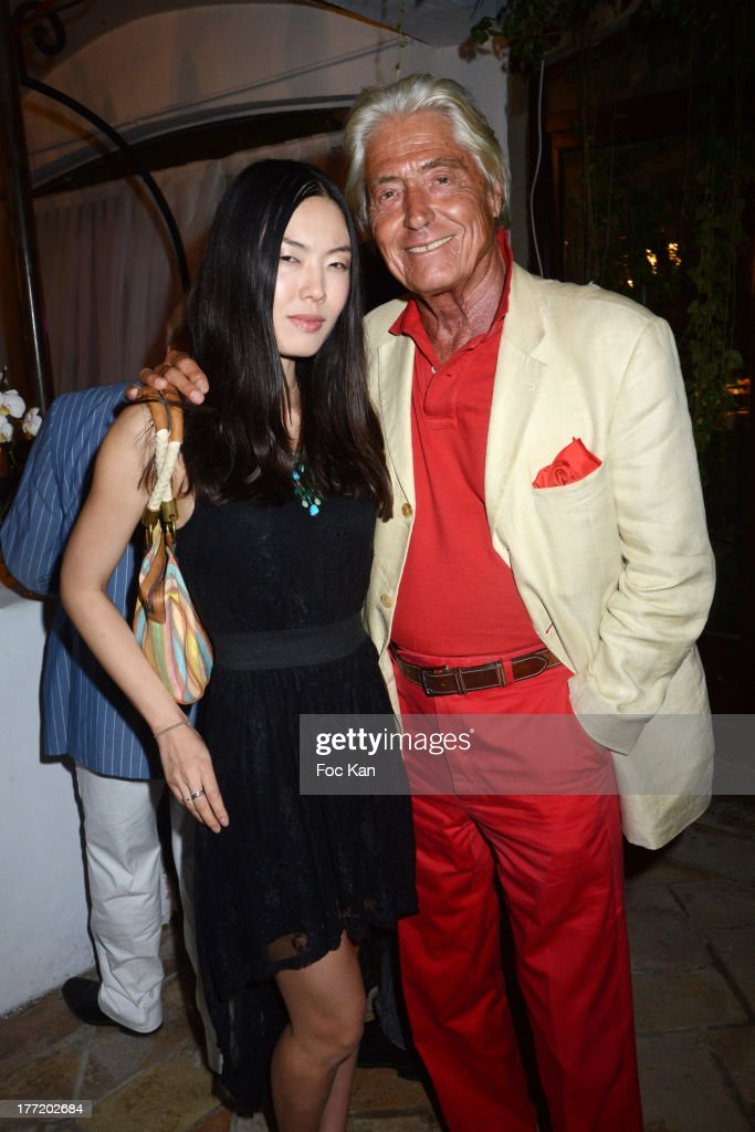 Maitre Pierre Cornette de Saint Cyr (R) and Yoko Koko attend the Massimo Gargia's Birthday Dinner at Moulins de Ramatuelle on August 21, 2013 in Saint Tropez, France.