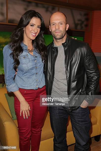 Maity Interiano and Jason Statham are seen on the set of Univision's 'Despierta America' to prmote the movie 'Homefront' at Univision Headquarters on...