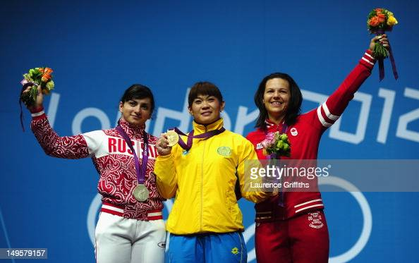 Maiya Maneza of Kazakhstan stands on the podium with the Gold medal Svetlana Tsarukaeva of Russia the Silver and Christine Girard of Canada the...