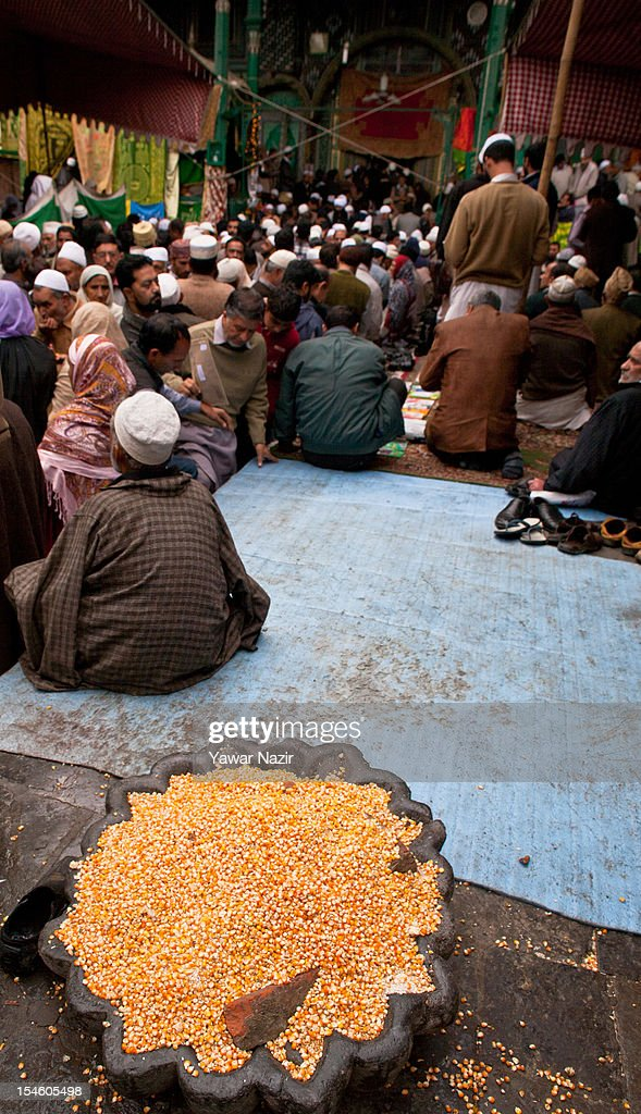 Maize is left for birds by Kashmiri Muslim devotees at the shrine of Khaniqahi mullah during a festival on October 23, 2012 in Srinagar, the summer capital of Indian administered Kashmir, India. Thousands of Muslims thronged to the shrine of Mir Syed Ali Hamadan to commemorate the anniversary of the death of the Sufi saint, Hamadan. He is believed to be responsible for the spread of Islam in Kashmir. The shrine gains a special significance on 6th of Zilhaj (last month of Muslim calendar), the death anniversary of Mir Syed Ali Hamadan. On this day, devotees visit the shrine in large numbers to pay a tribute to saint Hamadan.