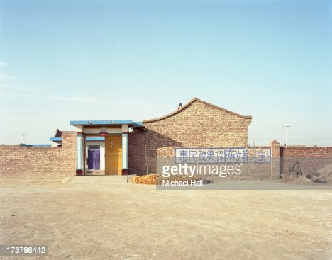 Maize stacked outside house : Stock Photo