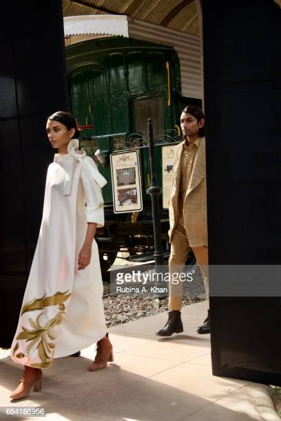 Maize wheat stalks and flower motifs dominate Samant Chauhan's designs on ivory and gold muga silk at the Golden Threads of Assam show at the...