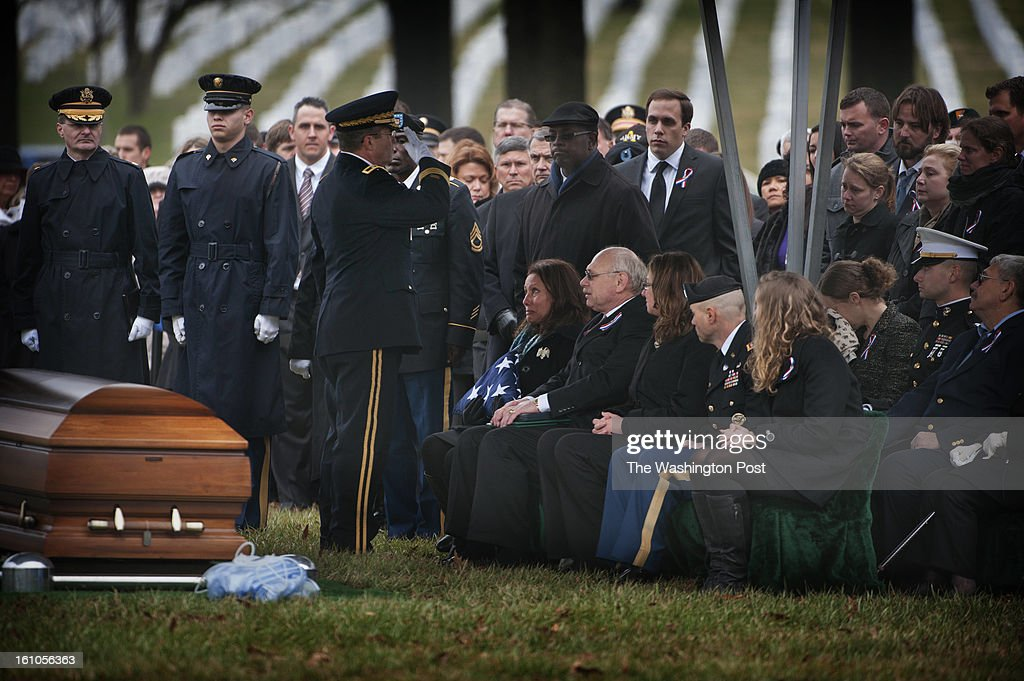 Maj. Gen. Thomas Seamands (left, saluting) presents the flag to Bertha and Duane Wittman (Sgt. Wittman's parents) during the burial service for U.S. Army Sgt. Aaron X. Wittman at Arlington National Cemetery on Friday, February 8, 2013. 28, Sgt. Wittman was supporting Operation Enduring Freedom at the time of his death. He was the first combat KIA of 2013. Sgt. Wittman is from Chester, VA.