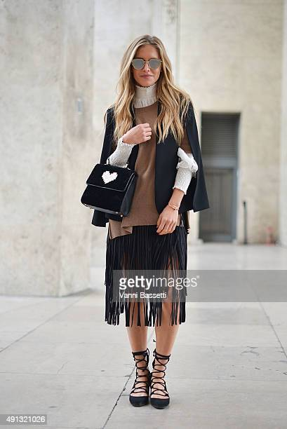 Maja Malnar poses wearing an Isabel Marant pull Zara skirt and shoes Les Petits Joueurs bag and Dior sunglasses before the John Galliano show at the...
