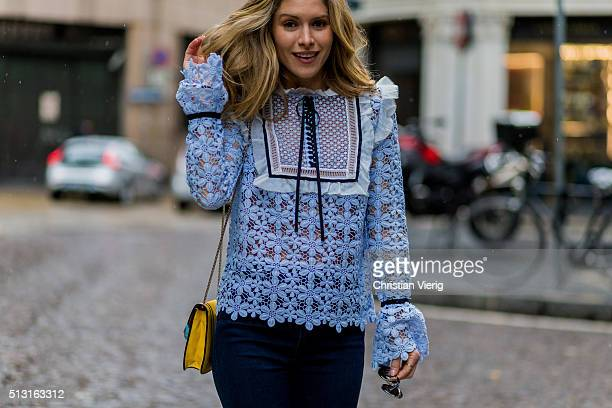 Maja Malnar wearing a babyblue blouse by Mrself portrait navy jeans from Mother denim Bulgari bag Taylor Morris sunglasses seen during Milan Fashion...