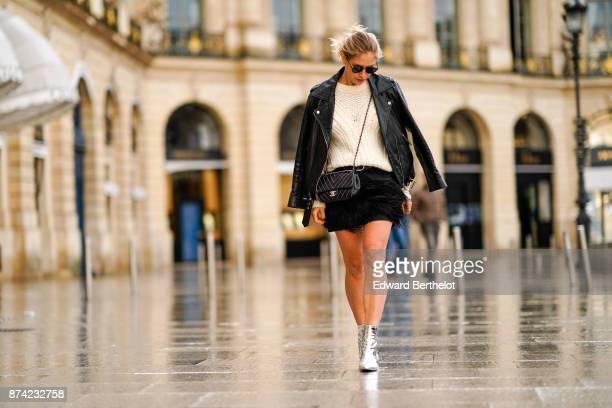 Maja Malnar wears Balenciaga silver boots a Milly black fringe skirt a Maje white wool sweater an Acne black leather pefecto jacket Taylor Morris...
