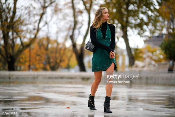 Maja Malnar wears Casadei black shoes with zippers a Revolve by NBD green dress a Sandro black turtleneck top a Zara faux fur brown jacket a Chanel...