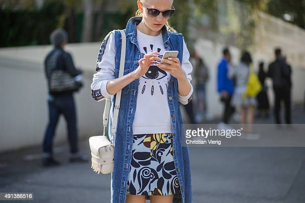 Maja Salamon looks at her smartphone during the Paris Fashion Week Womenswear Spring/Summer 2016 on October 4 2015 in Paris France