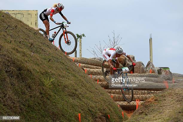 Maja Wloszczowska of Poland and Jolanda Neff of Poland race during the Women's CrossCountry Mountain Bike Race on Day 15 of the Rio 2016 Olympic...