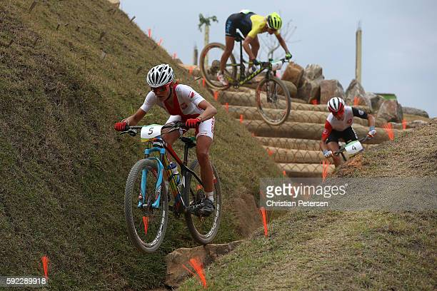 Maja Wloszczowska of Poland Jolanda Neff of Poland and Annika Langvad of Denmark race during the Women's CrossCountry Mountain Bike Race on Day 15 of...