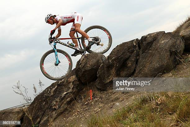 Maja Wloszczowska of Poland races during the Women's CrossCountry Mountain Bike Race on Day 15 of the Rio 2016 Olympic Games at the Mountain Bike...