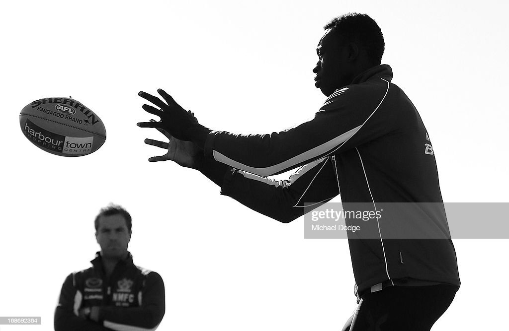 Majak Daw marks the ball during a North Melbourne Kangaroos AFL training session at Aegis Park on May 14, 2013 in Melbourne, Australia.