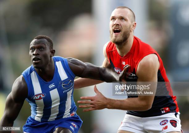 Majak Daw of the Kangaroos and Max Gawn of the Demons compete in a ruck contest during the 2017 AFL round 19 match between the North Melbourne...